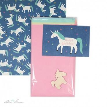 Geschenkpapier Einhorn, blau, bunte Sterne